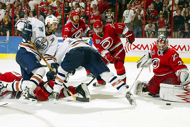 The two scrappy, unlikely finalists faced-off for the Cup in Carolina's tumultuous RBC Center with the 'Canes taking a 2-0 lead after two periods on unlikely goals from low-scoring defensemen Frantisek Kaberle and Aaron Ward. Rookie goaltender Cam Ward justified his Conn Smythe Trophy with a brilliant 22-save performance spoiled only by Fernando Pisani's tally in the third period. Justin Williams iced the Cup by scoring with 1:01 left as Edmonton's Chris Pronger made a futile dive to stop the puck before it entered the empty net.