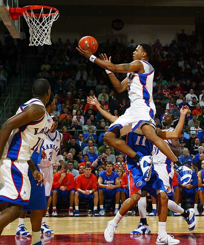 This was one of the most eagerly anticipated regular-season games in  years -- with the defending-champ Gators returning all five starters  and the Jayhawks SI's pick to win the 2007 title -- and it did not  disappoint. Sophomore Julian Wright scored 21 points and assisted on  Brandon Rush's game-winning basket in overtime, as KU ended Florida's  17-game winning streak with an 82-80 final in a neutral-court clash in Las Vegas.