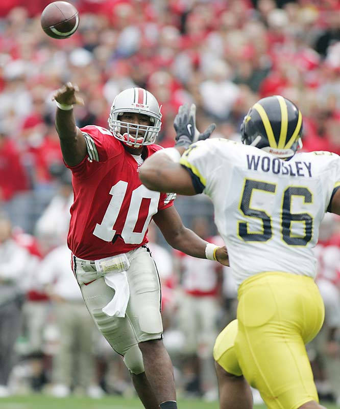 The first No. 1 vs. No. 2 matchup in the rivalry's 103-game series ended with the Buckeyes outlasting the Wolverines, 42-39, at Ohio Stadium. Playing spiritedly for the memory of former head coach Bo Schembechler, who passed away the day before the big game, Michigan rallied from a 28-14 halftime deficit to within three points by game's end. Eventual Heisman Trophy-winner Troy Smith was 29 of 41 for 316 yards and four TDs. Junior wide receiver Ted Ginn Jr. hauled in eight receptions for 108 yards.