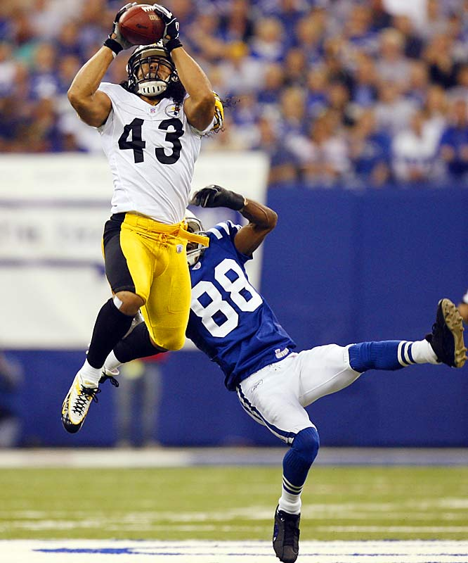 The Steelers dominated for almost four quarters but the final minutes were crazy. Troy Polamalu (left) picked off a Peyton Manning pass, started to run, fumbled and recovered the ball. Replay ruled the pass incomplete and Indy went on to score a TD that cut their deficit to 21-18. The Steelers got the ball deep in Colts territory with less than two minutes left, but Jerome Bettis fumbled. Indy's Nick Harper recovered and was racing for the winning TD. Miraculously, Steelers QB Ben Roethlisberger tripped Harper near midfield. The usually reliable Mike Vanderjagt then missed the tying 46-yard field goal in the final second.