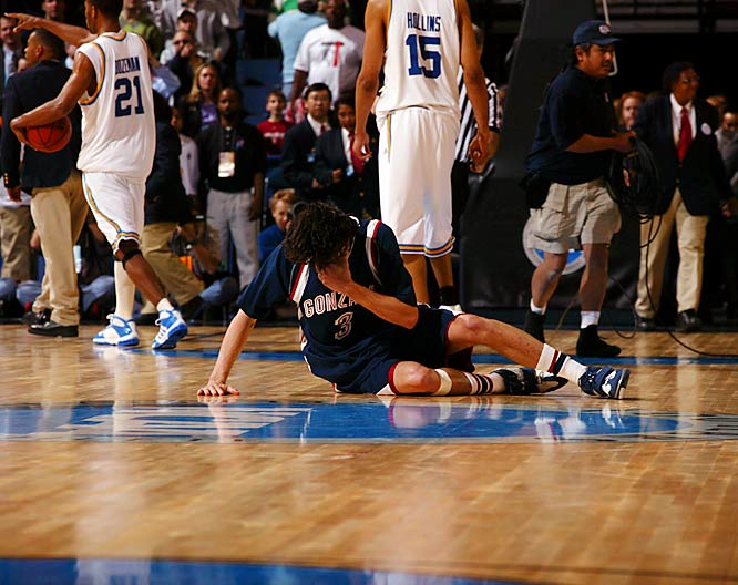 All of the 2006 NCAA tournament's greatest moments occurred  <i>before</i> the Final Four -- and the Bruins' amazing comeback over  the Zags was the best of them all. Trailing by 17 in the first half,  and nine late in the second, UCLA scored the final 11 points to stun  All-American Adam Morrison and the Zags. Morrison lay on the floor  crying after the gun -- an image that fans will no doubt remember for  years -- while Bruins freshman Luc Richard Mbah a Moute (who hit the  game-winner) and his teammates celebrated their 73-71 victory.