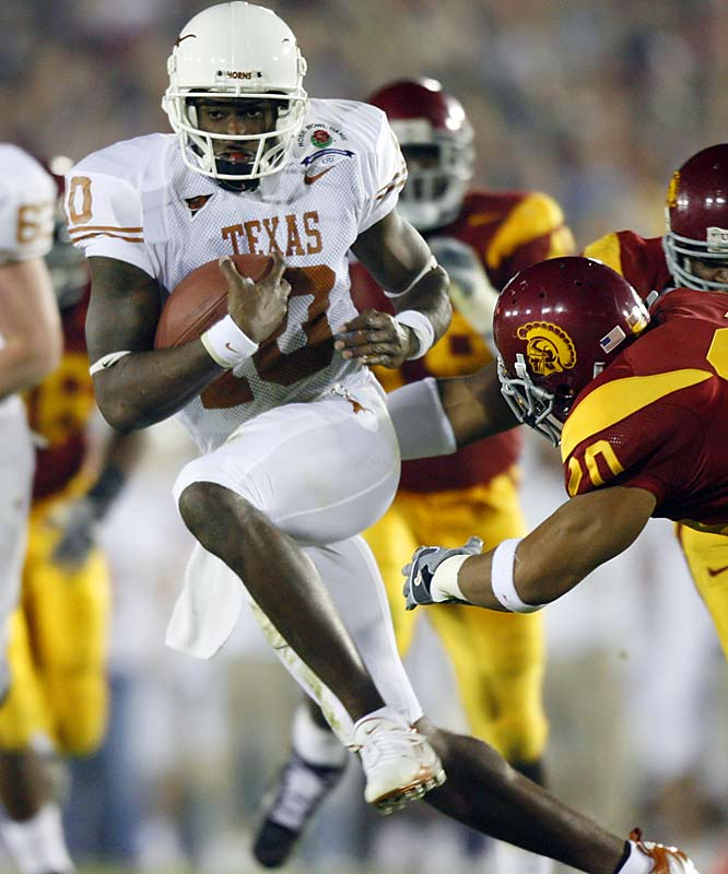 Vince Young almost single-handedly led Texas to its first national title in 35 years with a performance of legendary proportions. The electrifying quarterback was 30-of-40 passing for 267 yards and rushed for 200 yards and three touchdowns -- including the game-winning 8-yard scamper with 19 seconds left -- to lift the Longhorns to a thrilling 41-38 victory over No. 1 USC in the Rose Bowl.