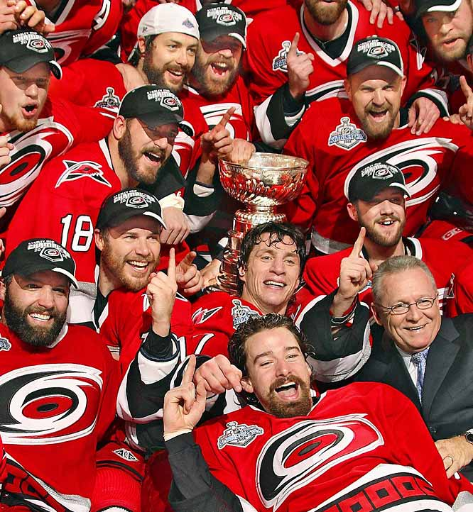 Playoff MVP Cam Ward (behind GM Jim Rutherford) became the third rookie goalie since 1971 to lead his team to the NHL title, and 16-year veteran Rod Brind'Amour (left of Ward) finally got to rejoice with the Cup as the Carolina Hurricanes defeated the surprisingly resilient Edmonton Oilers in seven games.