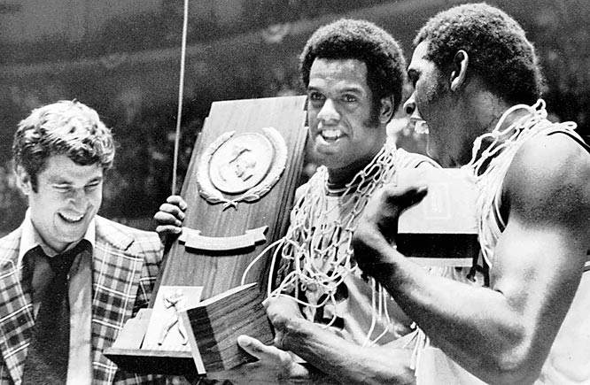 Knight has always sought perfection from his players, whether on the practice court or in the classroom. In 1976 he got it. Pictured with Scott May (center) and Quinn Buckner (right), the Hoosiers celebrated after capping a 32-0 season with a win over Michigan, 86-68, to win the national title. No team has gone undefeated since.