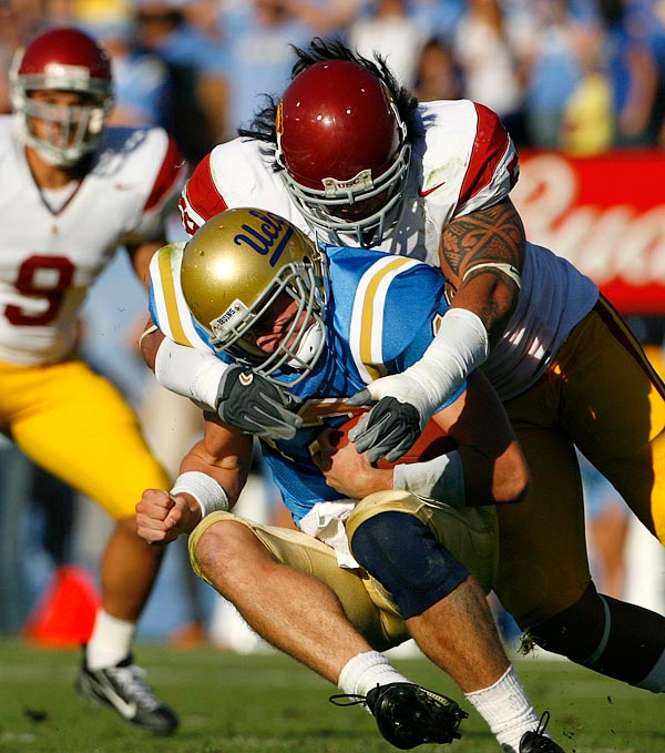 Not everything went right for UCLA. USC middle linebacker Rey Maualuga broke through for this sack of quarterback Patrick Cowan as Mozique McCurtis looked on.