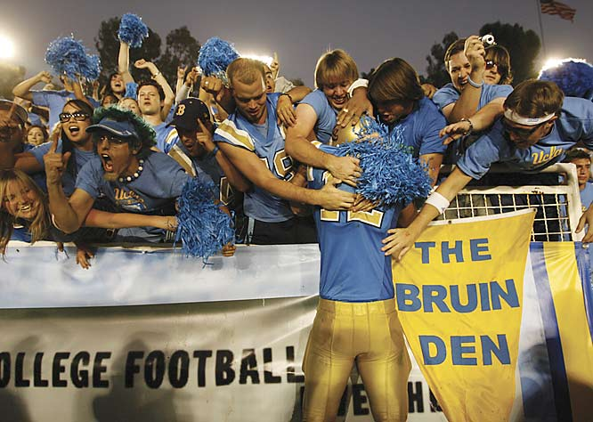 UCLA's defensive end Chinonso Anyanwu went up and into the Bruin Den to celebrate UCLA's upset victory over USC at the Rose Bowl.