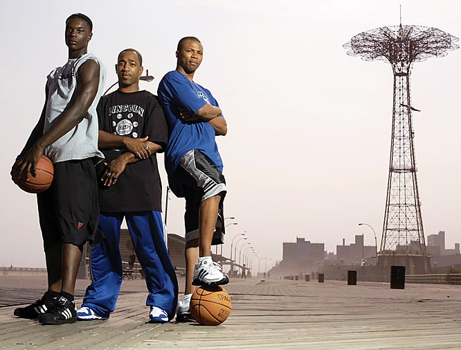 Lincoln (Brooklyn, N.Y.) sophomore guard Lance Stephenson (left), who's considered New York's top boys' basketball player, stands on the Coney Island boardwalk with Lincoln head coach Tiny Morton and former Railsplitters star Sebastian Telfair (right), who now plays for the Boston Celtics.