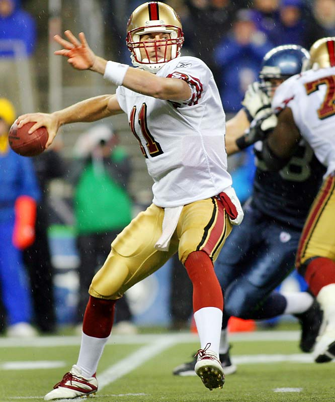 Quarterback Alex Smith's three fourth-quarter touchdowns -- two passing, one running -- prevented Seattle from clinching its third consecutive division title Thursday night.