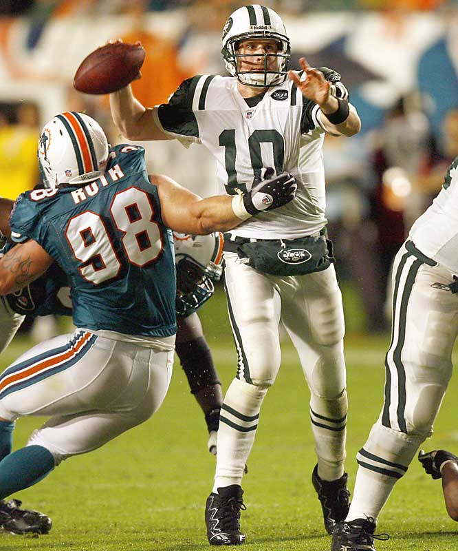 After a scoreless first half, Chad Pennington and the Jets managed to edge Miami for the win in a Monday-night matchup marred by steady rain and sloppy play.