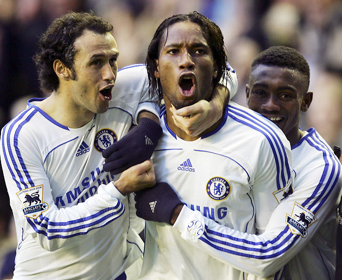 Didier Drogba (center) celebrates with teammates Ricardo Carvalho and Salomon Kalou after his 87th-minute goal ensured Chelsea a victory at Goodison Park. Drogba has 10 goals through 18 matches, tops in the Premiership.
