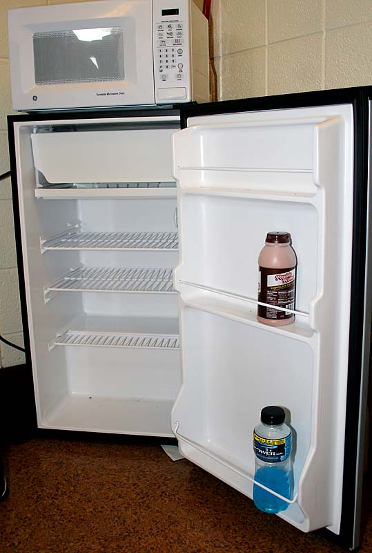 "Juice and CJ stock their refrigerator irregularly, which accounts for its sparse contents. When they do go to ""Late Night,"" where Illinois students stock up on groceries using their meal plans, they usually fill the fridge with drinks."