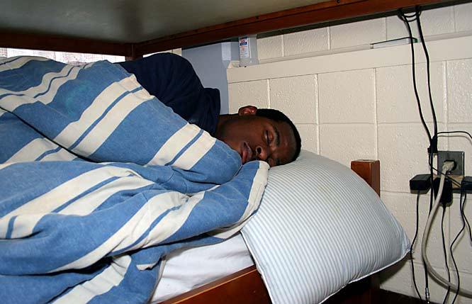 "Juice and CJ debunked their beds, but lofted one to maximize space in their room. Juice sleeps on the bottom with his head tucked under CJ's bed, a set up that works well -- until he sleeps in and almost misses morning weight lifting with strength coach Lou Hernandez. ""You know Coach Lou, I'm scared of Coach Lou if I'm running late,"" Juice says. ""I looked at my alarm too fast one morning; thought it said 7:15 when it was actually 6:15. I looked at it and just shot up like, DOO! I hit my head so hard."""