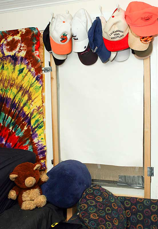 """Herbert's giant hat collection, including one from his dad's company J.J. Herbert and Co. """"I don't know why I have so many, I only wear four or five of them,"""" he said."""