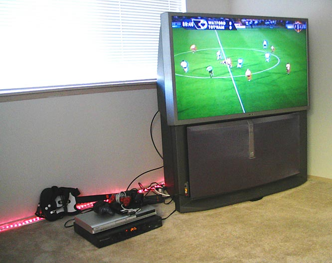 The view from the couch. Soccer is a mainstay on the screen and we're digging the mini guitar in the back.