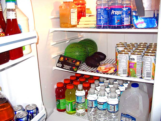 Fresh produce and a plethora of athletic beverages pack the refrigerator. Gotta love the watermelons and avocados, you don't see that everyday.