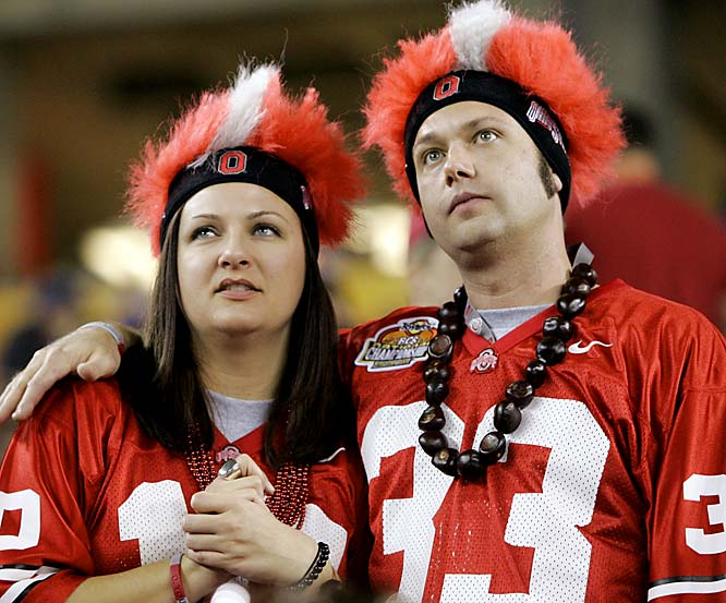 These Ohio State fans look miserable as they glance at the scoreboard late in the second half of Ohio State's 41-14 loss to Florida at the BCS national championship.
