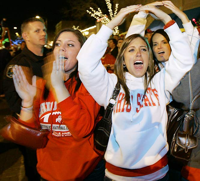 "These Buckeyes show their ""O Face"" during a BCS Championship Game rally Saturday night."