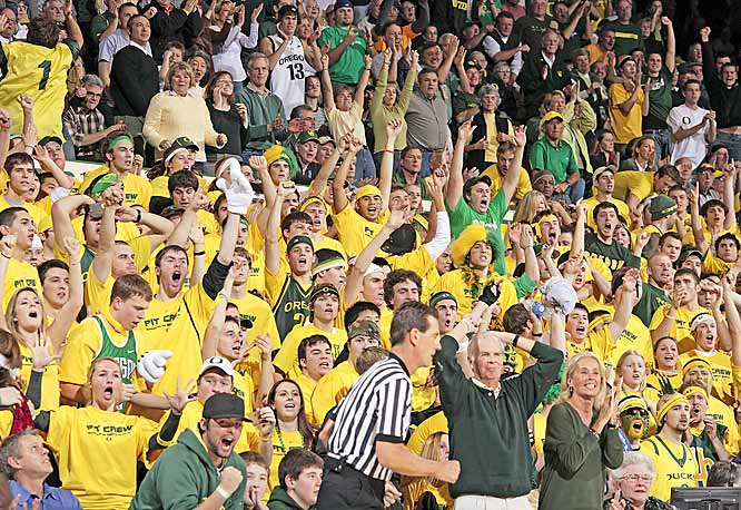 "Members of Oregon's ""Pit Crew"" go wild during the Ducks victory over UCLA on Saturday."