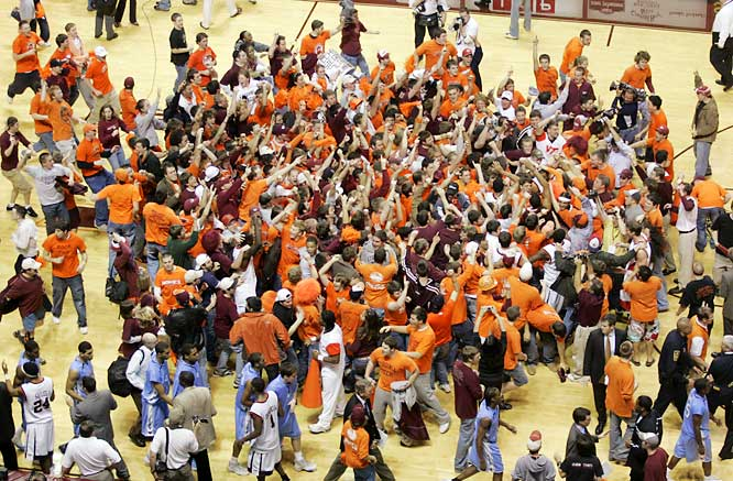 Virginia Tech fans celebrate after the Hokies 94-88 win over No. 1 North Carolina in Blacksburg, Va. on Saturday.