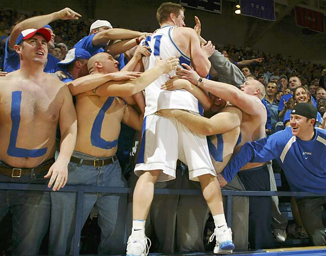Air Force forward Jacob Burtschi (21) jumps into the crowd after Air Force beat San Diego State 56-51 on Saturday.
