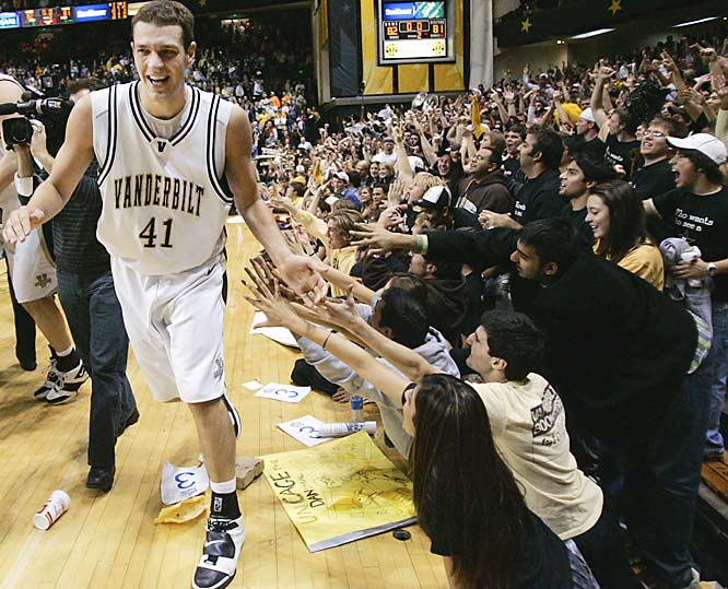 Vanderbilt forward Ross Neltner (41) celebrates with students after Vanderbilt upset Tennessee, 82-81, last Wednesday.