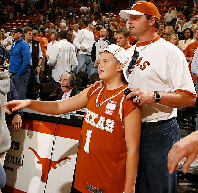 Roger Clemens, who compiled a 25-7 record in two seasons for the Longhorns, takes in the Texas-Baylor game with his son.
