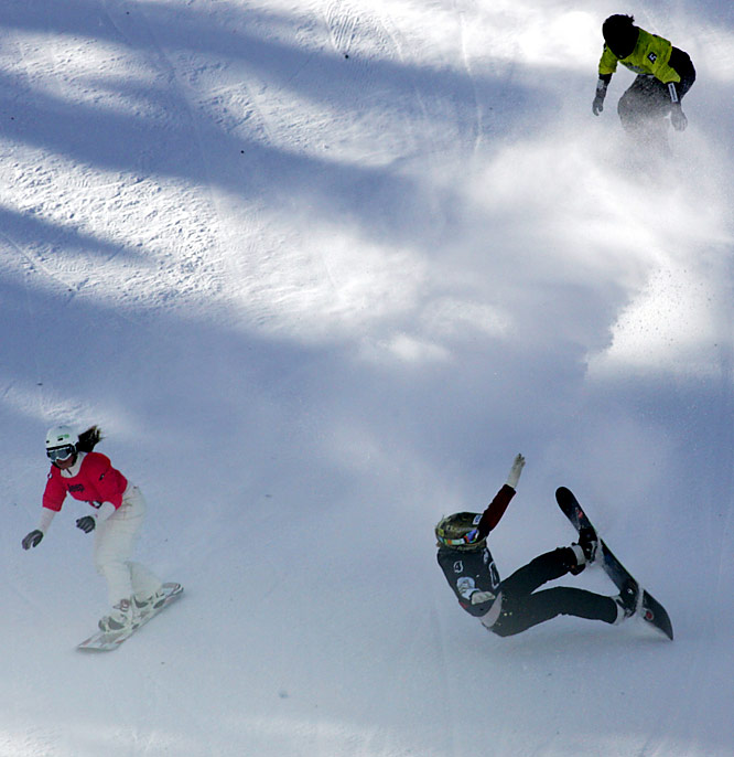 Deja vu? Jacobellis (lower right) lost gold at the 2006 Winter Olympics by wiping out during a celebratory trick. At this year's X Games, the snowboarder lost her balance and couldn't get her speed back in time, sliding on her back into second place.