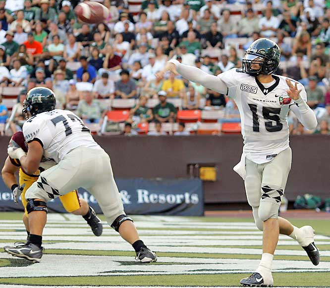 Hawaii's  Colt Brennan broke the NCAA single-season record for touchdowns, throwing five second-half TDs to finish with 58 on the season.