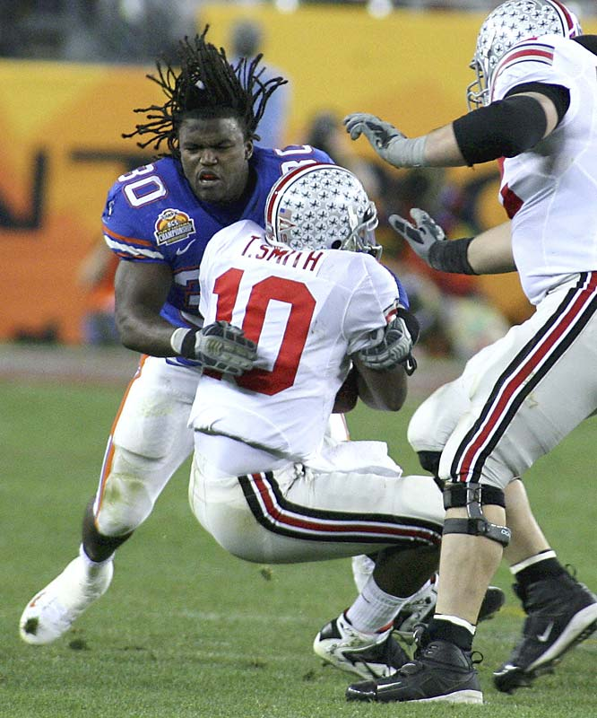 Earl Everett (30) hits Ohio State quarterback Troy Smith in the second half.