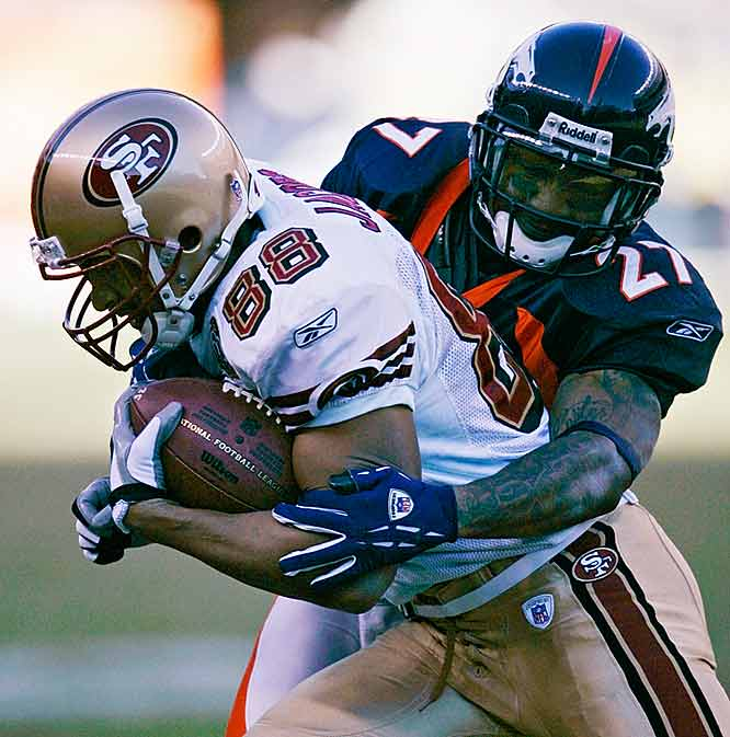 In what would be his last game, Williams tackles the 49ers' Taylor Jacobs during the Broncos' loss in the regular season finale on Sunday. Hours later, Williams was fatally wounded in a drive-by shooting.