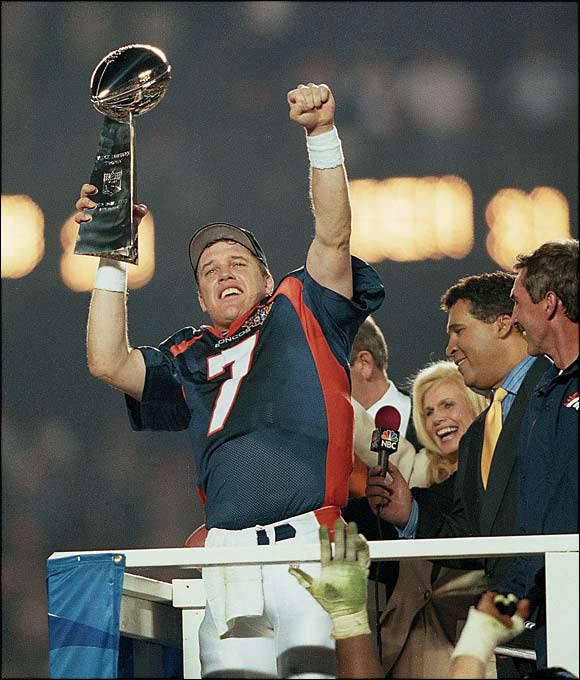On his fourth try, Bronco QB John Elway finally won the big one with an assist from game MVP Terrell Davis (157 yards rushing; Super Bowl-record three TDs). Elway threw for only 123 yards in the 31-24 upset of Green Bay, but scored on third-and-goal in the second quarter and led a 13-play, 92-yard drive in the third. The lasting memory: Elway dashing for a first down on third-and-six from the Packer 12, being hit by tacklers, and whirling in the air.