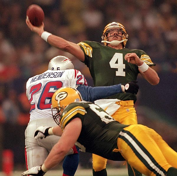 Favre completed 14 of 27 passes for 246 yards and two touchdowns to help the Packers beat the Patriots 35-21, bringing a championship back to Title Town for the first time since 1968.