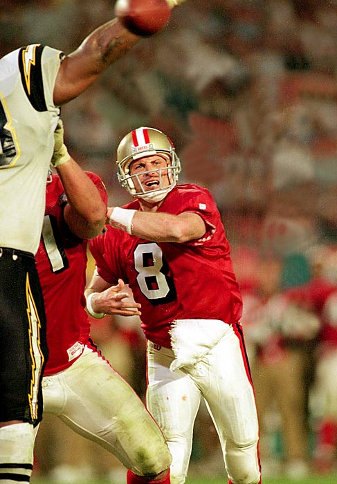 "Steve Young completed 24 of 36 passes for 325 yards and a Super Bowl-record six TDs in San Francisco's rout. With the win, the MVP Young (Joe Montana's understudy for two championship seasons in the Bay Area) got the proverbial ""monkey"" off his back and clinched the 49ers' fifth Super Bowl title -- a record at the time."