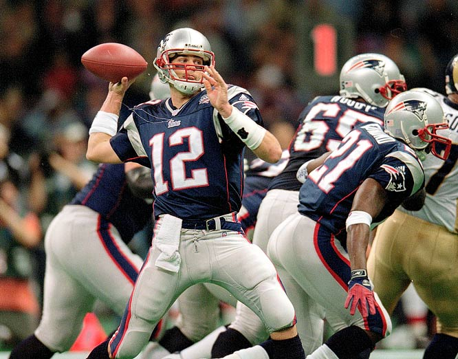 New England Patriots quarterback Tom Brady looking to pass downfield against the St. Lous Rams during Super Bowl XXXVI.