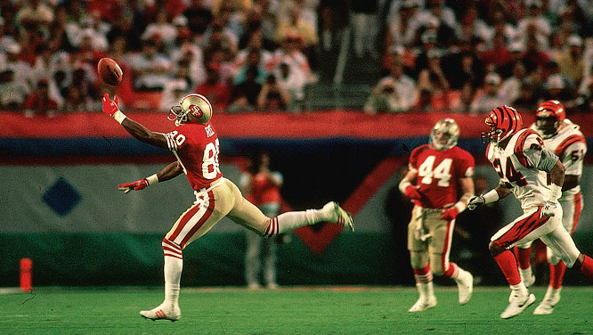 San Francisco 49ers wide receiver Jerry Rice stretching out to catch a pass with one hand against the Cincinnati Bengals in Super Bowl XXIII.