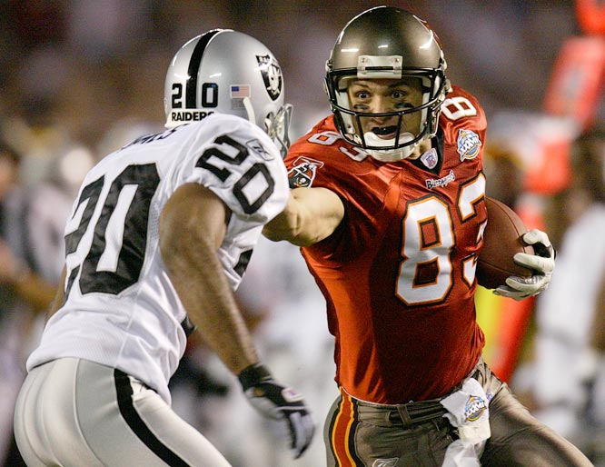 Tampa Bay Bucs wide receiver Joe Jurevicius applying a stiff arm to Oakland Raiders cornerback Tory James during the third  quarter of their Super Bowl matchup. The Bucs beat the Raiders 48-21.