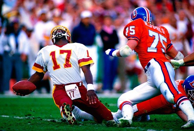 Washington Redskins quarterback Doug Williams sustains a leg injury during Super Bowl XXII against the Denver Broncos.