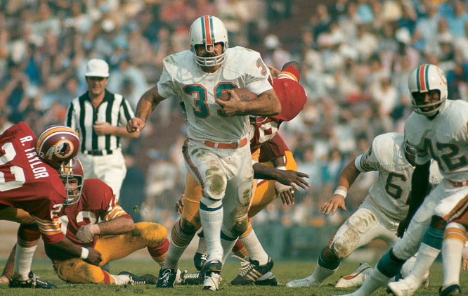 Larry Csonka of the Miami Dolphins blasting up the middle in Super Bowl VII on Jan. 15, 1973. The Dolphins defeated the  Redskins 14-7.