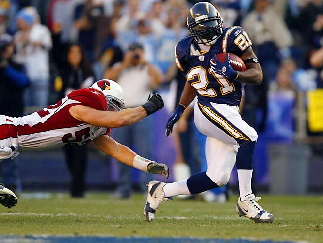 LaDainian Tomlinson ran for 66 yards on 16 carries against Arizona, giving him 1,815 yards for the season and the league rushing title. He edged out Larry Johnson of the division rival Chiefs by 26 yards.