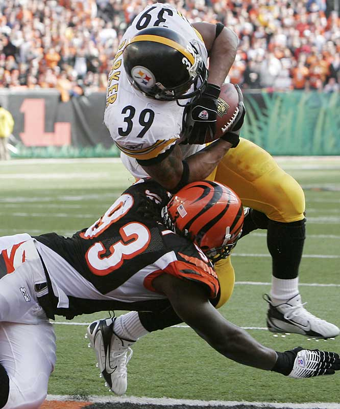 Willie Parker scores the first of his two 1-yard touchdown runs against Cincinnati to give him a franchise-record 16 for the season.  Parker had 134 yards on the ground as the Steelers knocked the Bengals out of playoff contention.