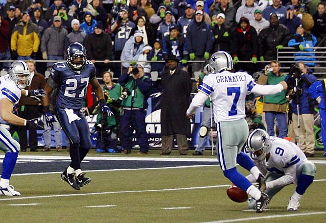 Tony Romo's bobbled snap cost Dallas a shot at its first postseason victory since 1996.