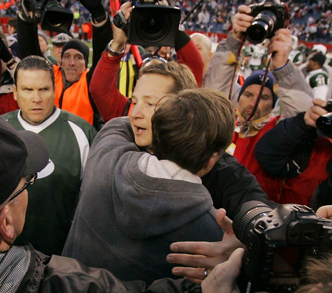 New England coach Bill Belichick (right) hugs his former assistant, Jets head coach Eric Mangini, a stark contrast to their November game, when Belichick barely made eye contact as he exchanged a cold handshake.