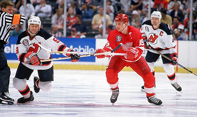 During the strike-shortened 1994-95 season, the Red Wings advanced to their first Stanley Cup final in 29 years. Alas, New Jersey proved too strong for Detroit. Here, Yzerman jostles with Devils forward Neil Broten in Game 3 of New Jersey's four-game sweep.
