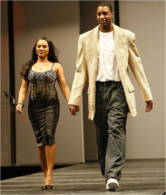 Tracy McGrady and his wife CleRenda strut their stuff as they walked the catwalk during a charity fashion show
