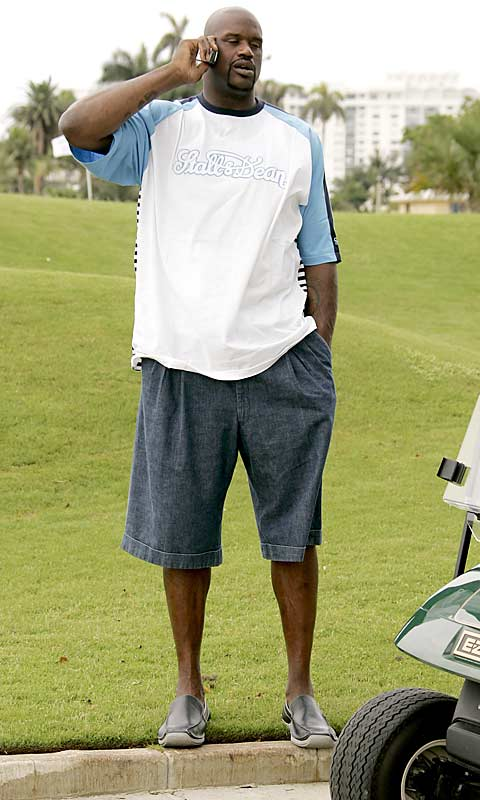 Shaquille O'Neal takes a minute to make a phone call during the 2006 Celebrity Golf Tournament in Miami last summer.