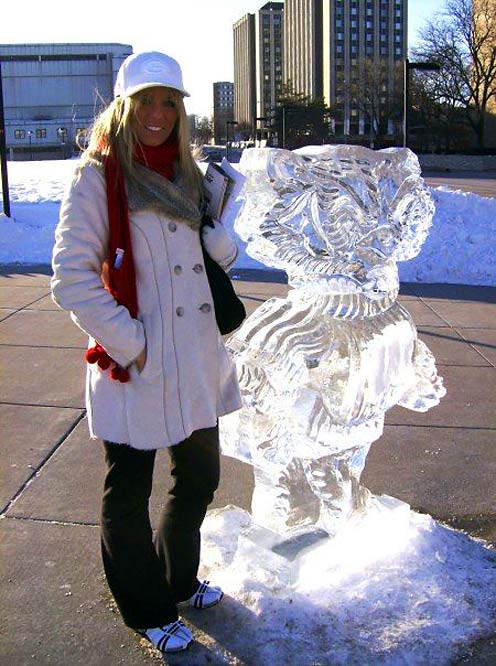 Brigid poses outside with the badger ice structure.