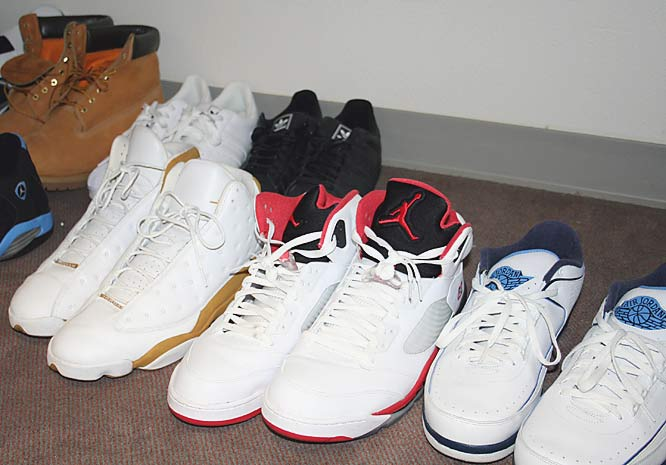 It's hard not to trip over all these shoes. Amid the mass of Air Jordans we spot a couple pairs of Adidas in the back.