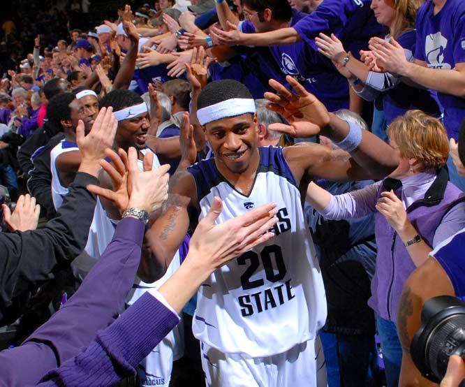 Kansas State forward Cartier Martin high fives fans after the Wildcats defeated Missouri, 80-73, on Wednesday.