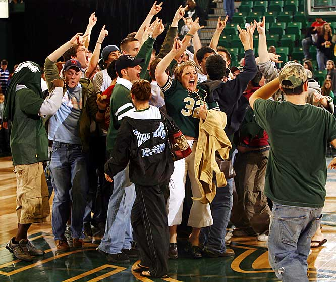 South Florida fans celebrate the Bulls' 69-63 upset over Notre Dame on Saturday night in Tampa.