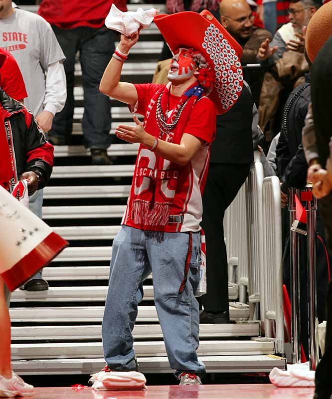 An Ohio State student celebrates in the stands after the Buckeyes defeated Purdue, 76-63, in Columbus on Tuesday.